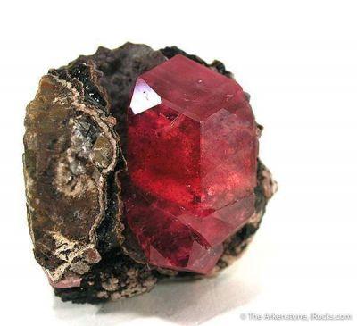 Rhodochrosite on Black Geothite