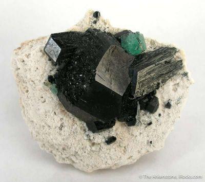 Schorl, Foitite, Fluorite on Feldspar