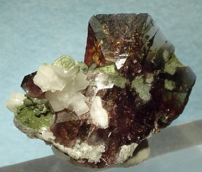 Axinite-(Fe), Calcite