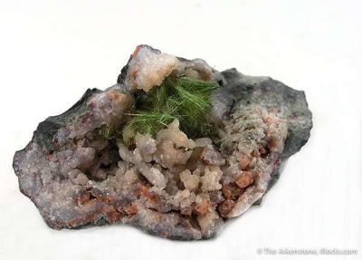 Honessite With Pyrite in Quartz Geode