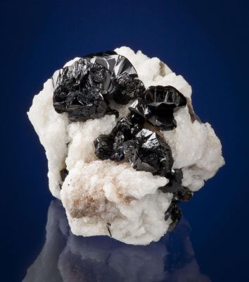 Cassiterite on Albite