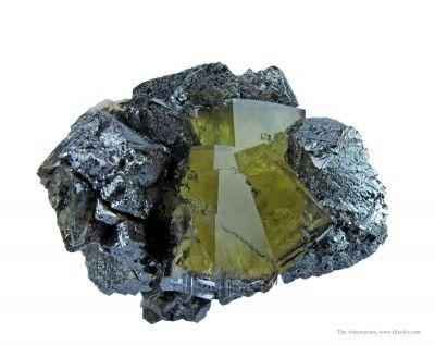 Twinned Fluorite and Sphalerite With Hydrocarbon Inclusions