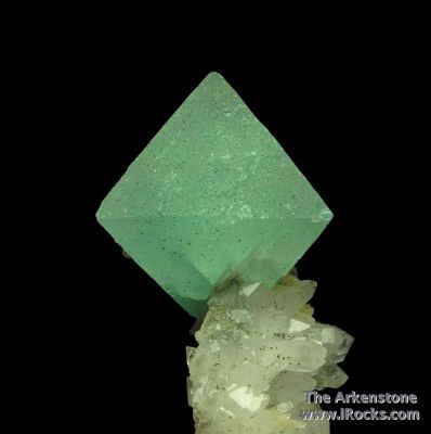 Fluorite (fluorescent) on Quartz
