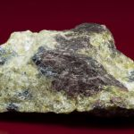 Althausite (type locality) with Hematite and Lizardite