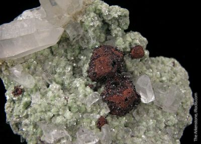 Hubnerite epimorph of Scheelite and Quartz, on Muscovite