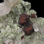 Hubnerite epimorph of Scheelite and Quartz, on Muscovite