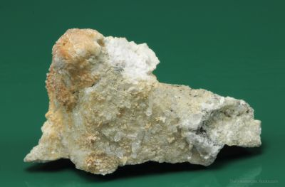 Monteregianite-(Y) (type locality) with Pectolite on Albite