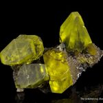 Sulfur on Aragonite with Petroleum inclusions