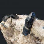Afghanite (TL) (fl) on Calcite (fl)